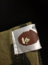 white and brown clothes tag