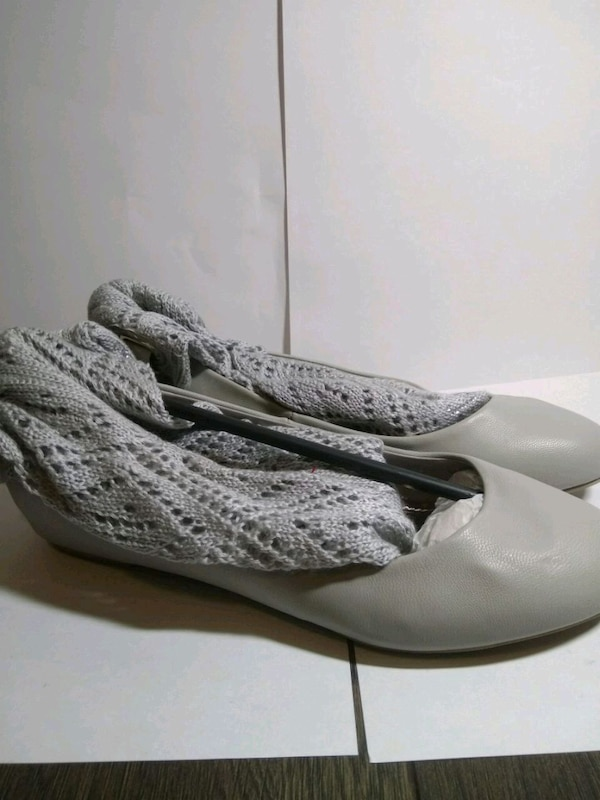 pair of white leather shoes