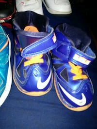 pair of blue-and-pink Nike basketball shoes 763 mi