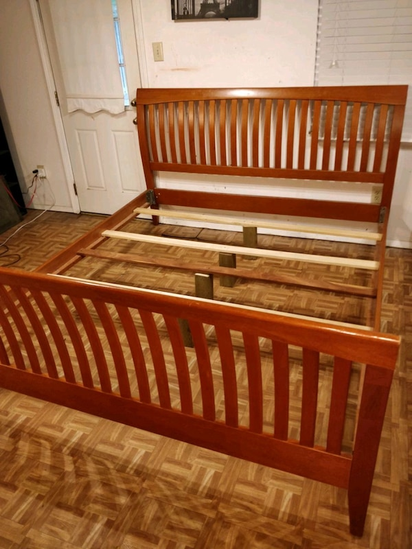 Nice solid wood KING bed frame in very good condit