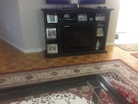 black wooden TV stand with flat screen television Toronto, M9P 2S1
