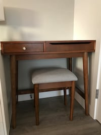 Brown wooden vanity table with chair