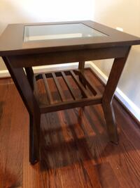 Glass top coffee table and end tables.  In great condition!