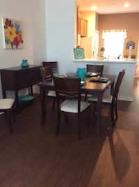 7 piece brown wood dining room set. $300. Table can be made to square . Orlando, 32828