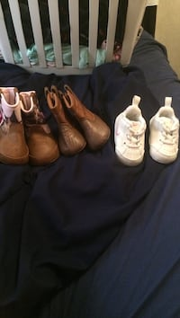 three pairs of brown and black leather boots Lost Creek, 26385