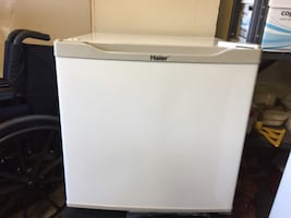 Small white and grey Haier refrigerator