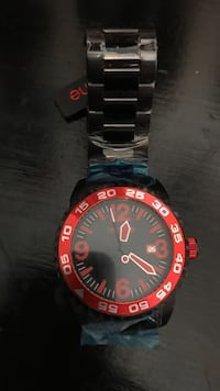 round black and red analog watch with link bracelet