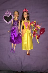 Bell and repunzel Barbie dolls