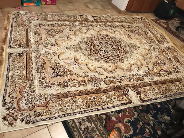 white and brown printed rug