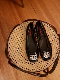 pair of women's black leather flats