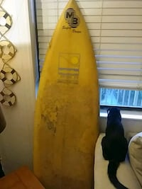 yellow and black surf board 757 mi