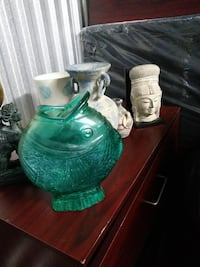 green glass fish vase
