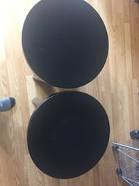 Two wooden round end tables McLean