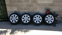 4 brand new rims and 4 new tires P225/50R17