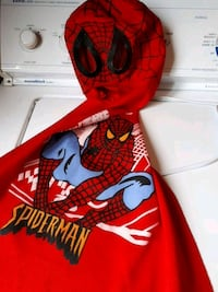 red and black Spider-Man print textile