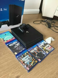 PlayStation 4 pro five games and two controllers Washington