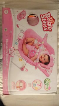 Baby's pink and white bouncer seat box 2173 mi