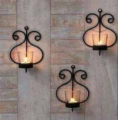 three black steel wall mount candle holder