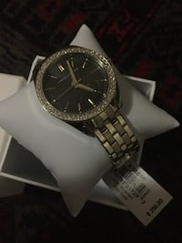 round black Michael Kors chronograph watch with silver link bracelet