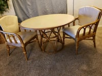 round brown wooden table with two chairs Oklahoma City, 73139