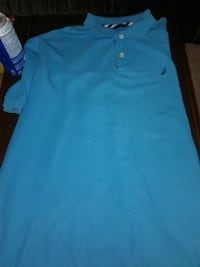 light blue  polo shirt Woodstock