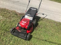 Red and black push mower Palm Bay, 32909