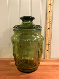 Vintage green amber glass vase container.