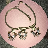 gold necklace with silver pendant