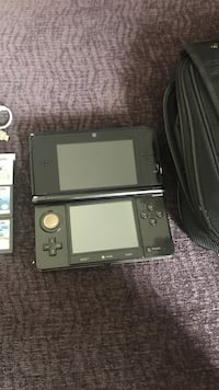 Nintendo 3ds with 12 games charger and carrying case Ventura, 93003
