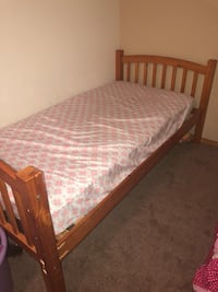 brown wooden bed frame with white mattress Greeley, 80634