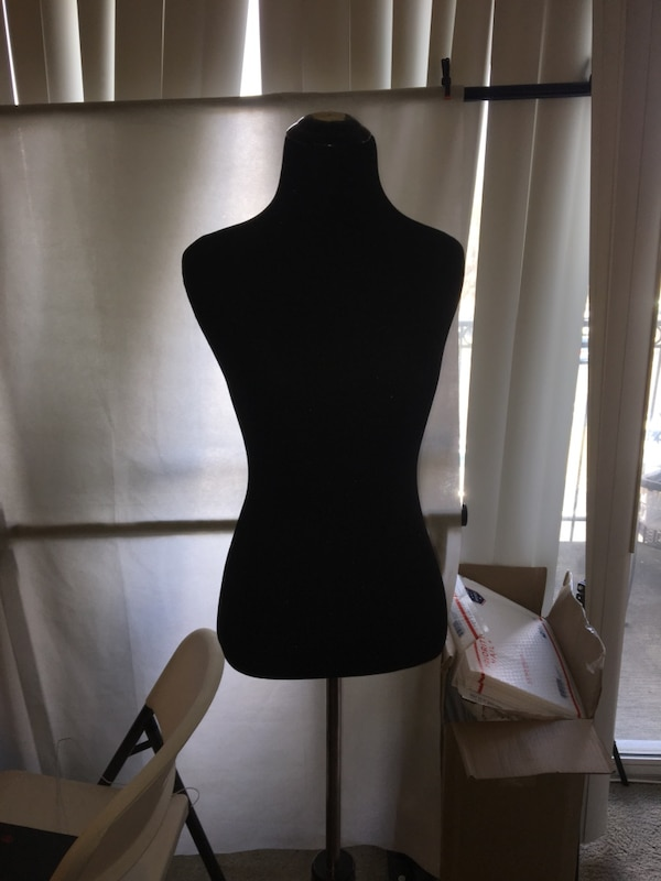 torso of a female mannequin with stand