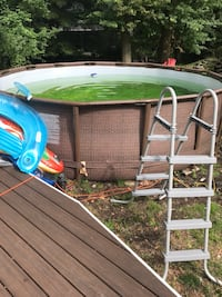 Green and gray above ground pool West Nyack, 10954