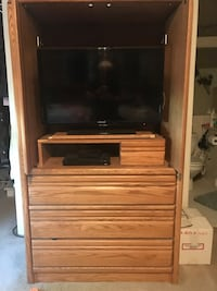 Solid oak tv armoire with storage    TV not incl SCHAUMBURG