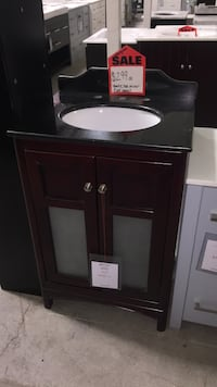 brown wooden cabinet with mirror