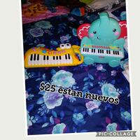 teal and pink Fisher Price elephant themed piano Germantown, 20874