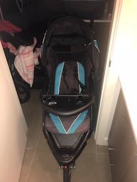 Baby's black and blue jogging stroller Port Coquitlam, V3C 3H1