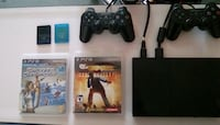 PlayStation 2 with 2 memory Cards 2 Paddels and 2 games Las Vegas