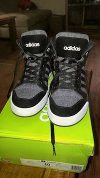 black-and-gray Adidas high-top sneakers