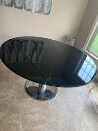 Black spinning marble dining table  West Des Moines, 50266
