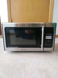 gray and black Emerson microwave oven
