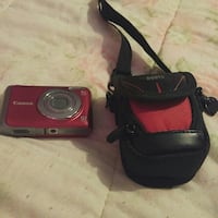 red Canon compact camera with black leather pouch Grenville, J0V 1J0