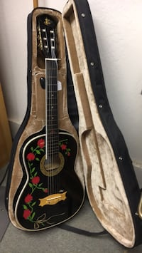 brown acoustic guitar with case Forestville, 95436