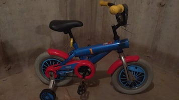 toddler's blue and red bicycle with training wheels. Great condition