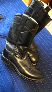 Pair of black leather boots Mission, 78573