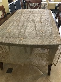 Rectangular black wooden table with white floral tablecloth Rockville, 20853