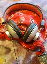 red and black corded headphones Vancouver, V6A 1X8