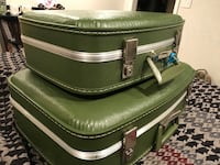 two green leather luggages
