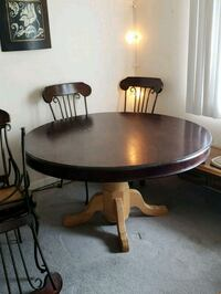 round brown wooden pedestal table with four chairs dining set Schaumburg, 60193