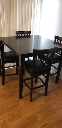 rectangular brown wooden table with four chairs dining set Porterville, 93257