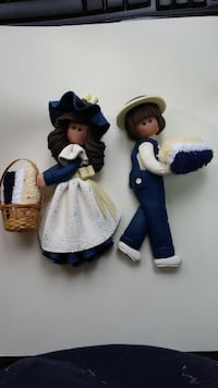 two white-and-blue ceramic figurines Hudson